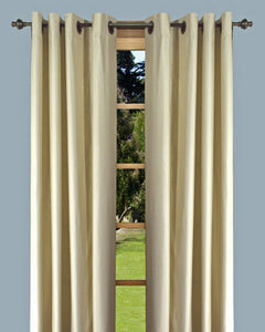 Ivory Elegance Insulated Grommet Panels hanging on a decorative curtain rod