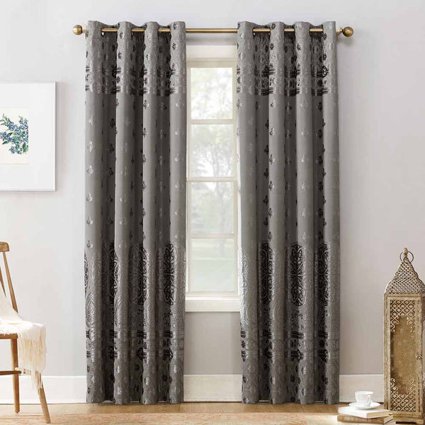 Grey Sun Zero Elidah Theater Grade Blackout Grommet Top Panel hanging on a decorative rod