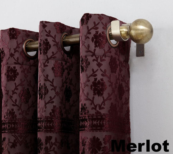 Close up Merlot Sun Zero Elidah Theater Grade Blackout Grommet Top Panel showing grommets