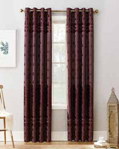 Merlot Sun Zero Elidah Theater Grade Blackout Grommet Top Panel hanging on a decorative rod
