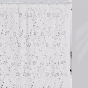 White Eyelet Fabric Shower Curtain Hanging On A Rod