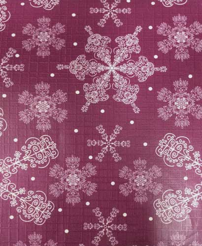Closeup of Burgundy Festive Holiday Snowflake Peva Table Cloth fabric