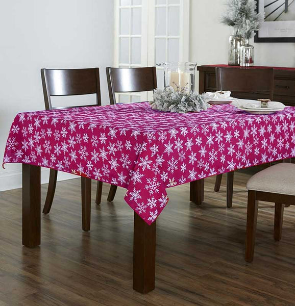 Burgundy Festive Holiday Snowflake Peva Table Cloth over a wooden Table