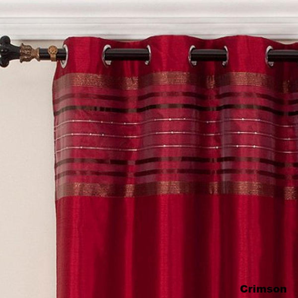 close up shot of Crimson Fiesta Faux Silk Grommet Top Panel fabric and grommets