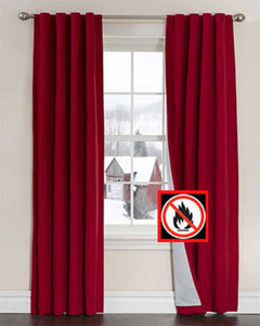 Red Firefend Flame Retardant Panels hanging on a decorative curtain rod