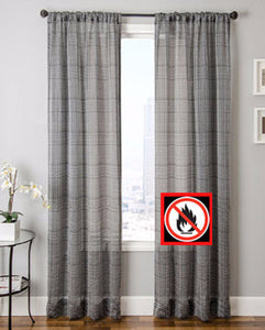 White/Black Flynn Flame Retardant Sheer Rod Pocket Panel hanging on a decorative rod