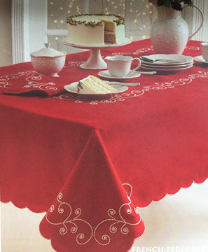 Red French Pearl Fabric Tablecloth over a table