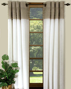 Grey/White Geneva Semi Sheer Grommet Top Panel hanging on a decorative curtain rod