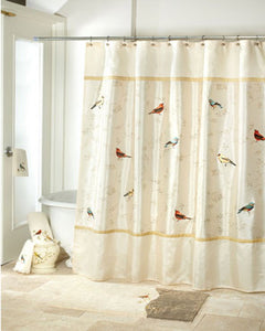 Ivory Gilded Birds Fabric Shower Curtain hanging on a shower curtain rod