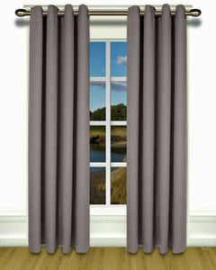Grey Glasgow Grommet Top Panel hanging on a decorative curtain rod