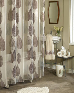 Beige Gossamer Leaf Fabric Shower Curtain hanging on a shower curtain rod