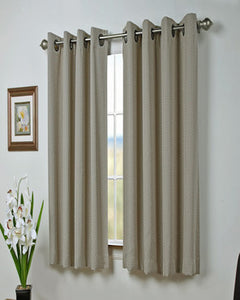 Natural Grand Pointe Grommet Shortie Panel Hanging on a decorative curtain rod