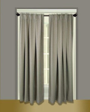 Grand Pointe Back Tab Panels hanging on a curtain rod