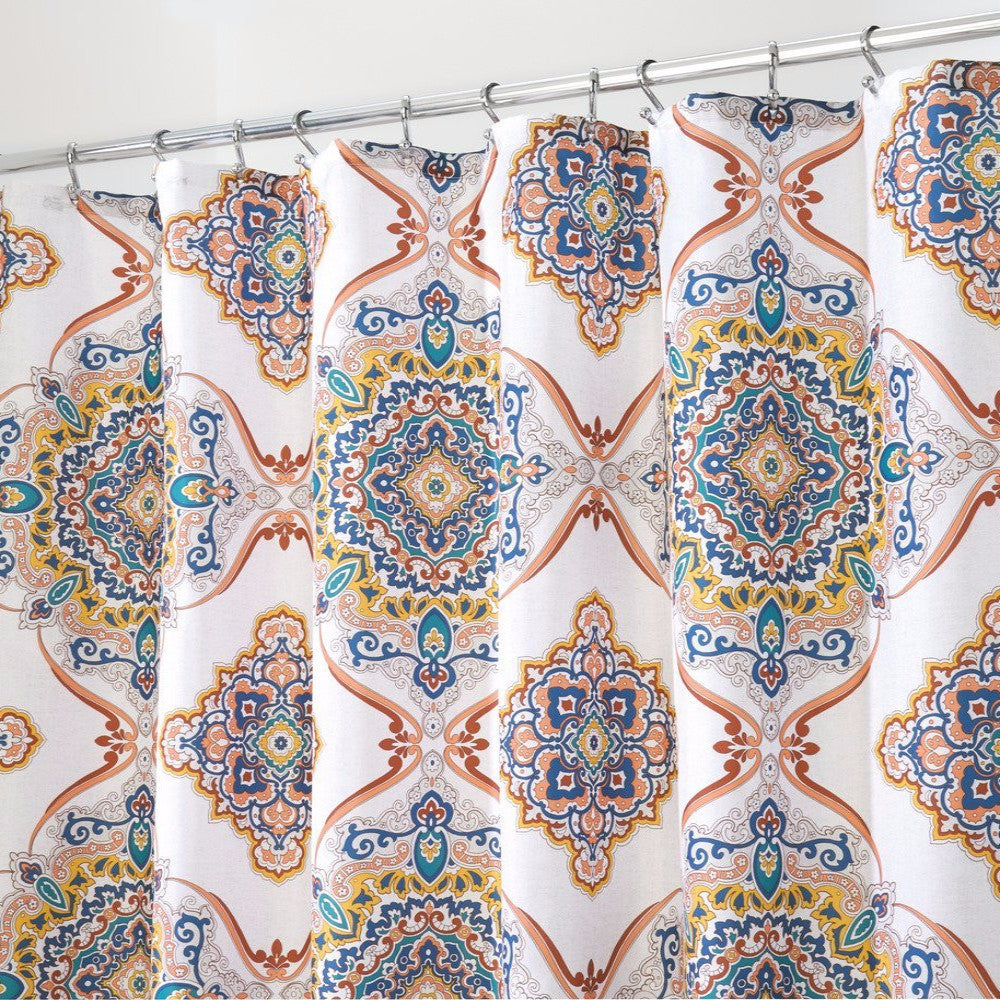 Closeup shot of Spice Henna Medallion Fabric Shower Curtain hanging on a shower curtain rod
