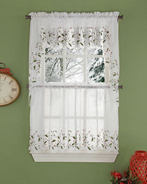 Holly Cutwork Semi Sheer Kitchen Valance, Swags, and Tier Curtains hanging on curtain rods