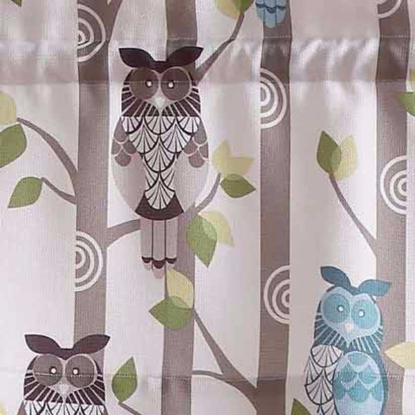Closeup of No. 918 Hoot Owl Print Kitchen Valance hanging on a curtain rod fabric