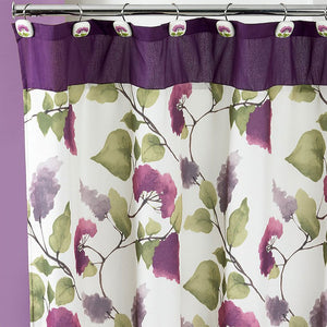 Closeup shot of Plum Jasmine Fabric Shower Curtain hanging on a shower curtain rod