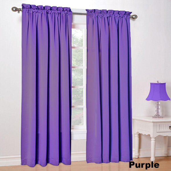 purple color Sun Zero Kylee Room Darkening Panels hanging in a room on a decorative curtain rod