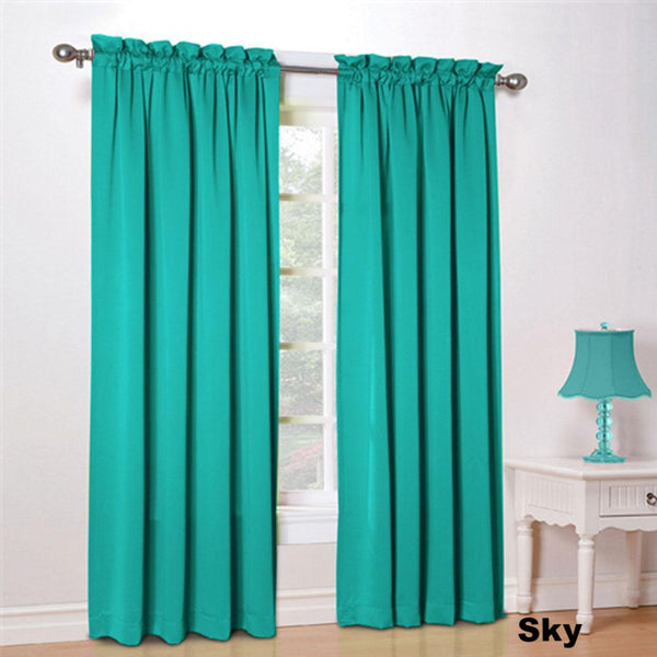 sky color Sun Zero Kylee Room Darkening Panels hanging in a room on a decorative curtain rod