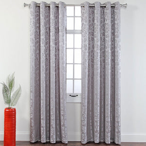 Stone Leah Jacquard Grommet Panel hanging on a decorative curtain rod