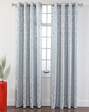 Mist Leah Jacquard Grommet Panel hanging on a decorative curtain rod