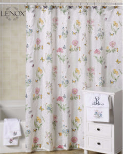 White Lenox Butterfly Meadow Fabric Shower Curtain hanging on a shower curtain rod