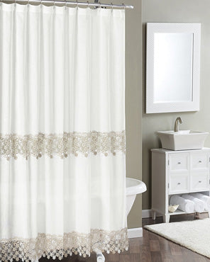 Ivory Lillian Macramé Band Fabric Shower Curtain hanging on a shower curtain rod