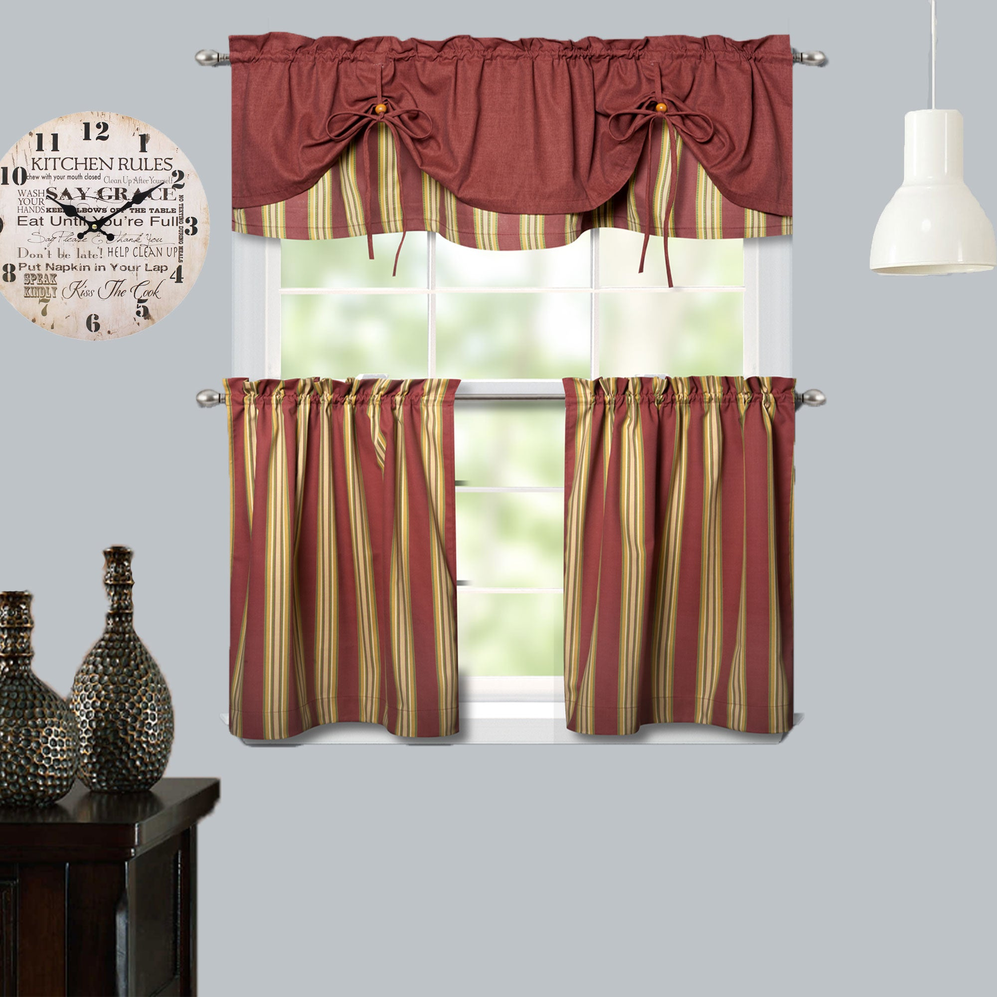 Salmon Lisa Stripe Tier and Tie-up Valance hanging on a curtain rod