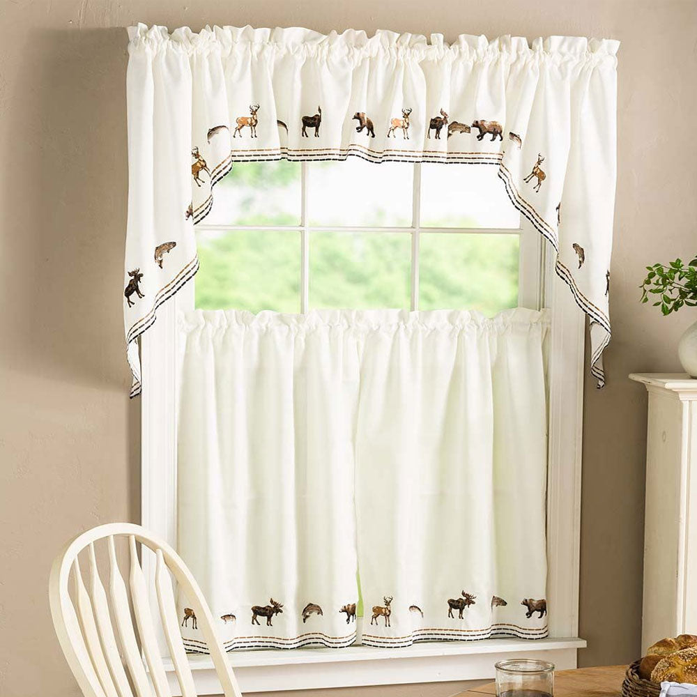 Lodge Embroidered Kitchen Valance, Swags, and Tier Curtains hanging on curtain rods