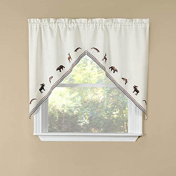 Lodge Embroidered Kitchen Swags hanging on a curtain rod