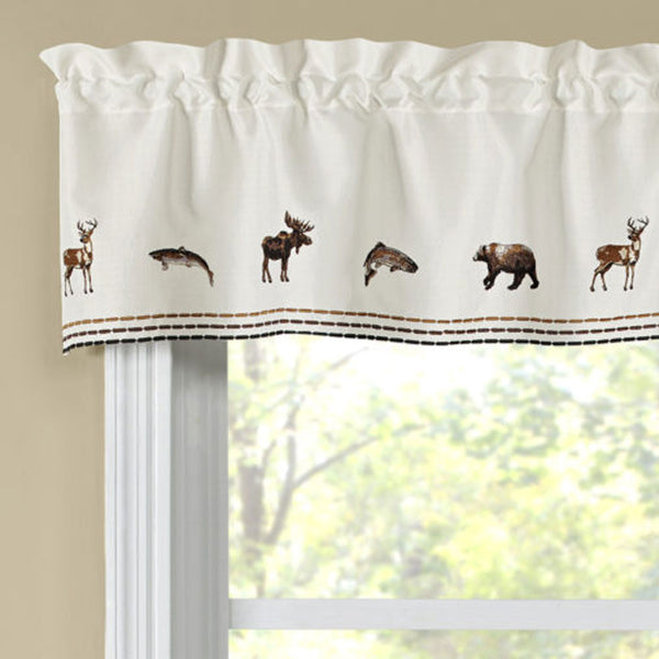 Lodge Embroidered Kitchen Valance hanging on a curtain rod