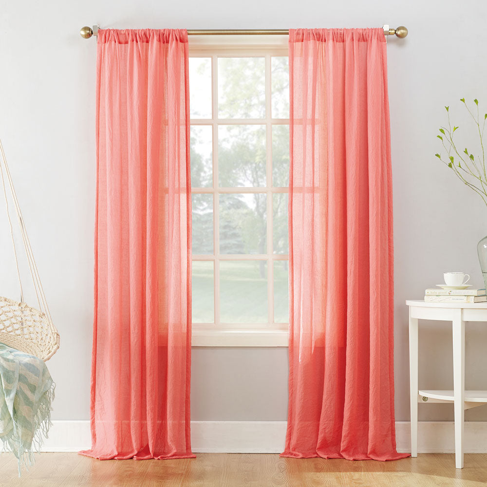 Coral No. 918 Lourdes Semi-Crushed Sheer Rod Pocket panels hanging on a decorative rod