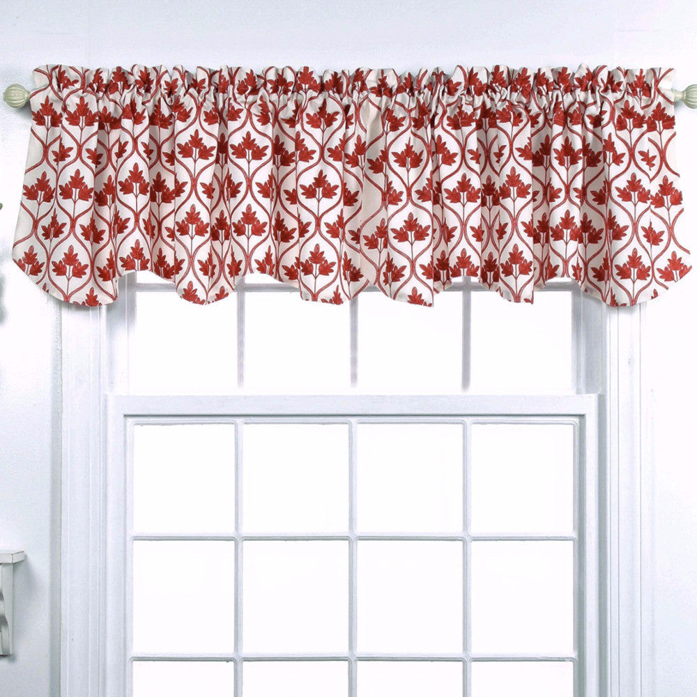 Mayfair Lined Embroidered Scalloped Valance hanging on a curtain rod