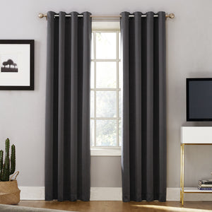 Sun Zero Oslo Theater Grade Blackout Room Darkening Grommet Top Curtain Panel hanging on a rod