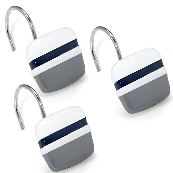 Close up shot of Navy Chantelle Fabric Shower Curtain shower hooks