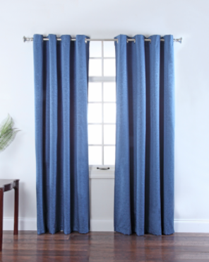Navy Portland Room Darkening Grommet Top Panels hanging on a decorative curtain rod