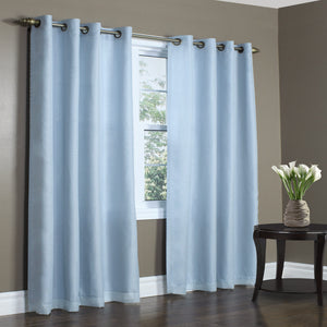 Rhapsody Thermalvoile Lined Grommet Top Sheer Curtains hanging on a decorative rod