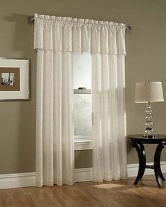 Renee Lined Sheer Curtains hanging on a decorative rod