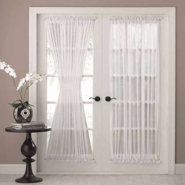 White Reverie Snow Voile door panel hanging on curtain rods over a french door