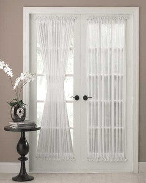 Reverie Snow Voile door panel hanging on curtain rods over a french door