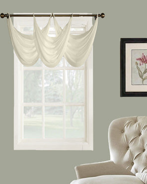 Thermavoile Rhapsody Grommet Ascot Valance hanging on a curtain rod