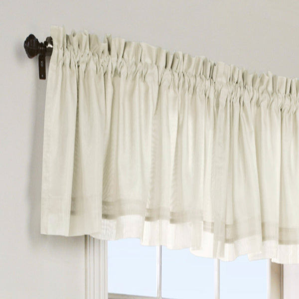 Ivory Rhapsody Lined Thermavoile Tailored Kitchen Valance hanging on a decorative rod