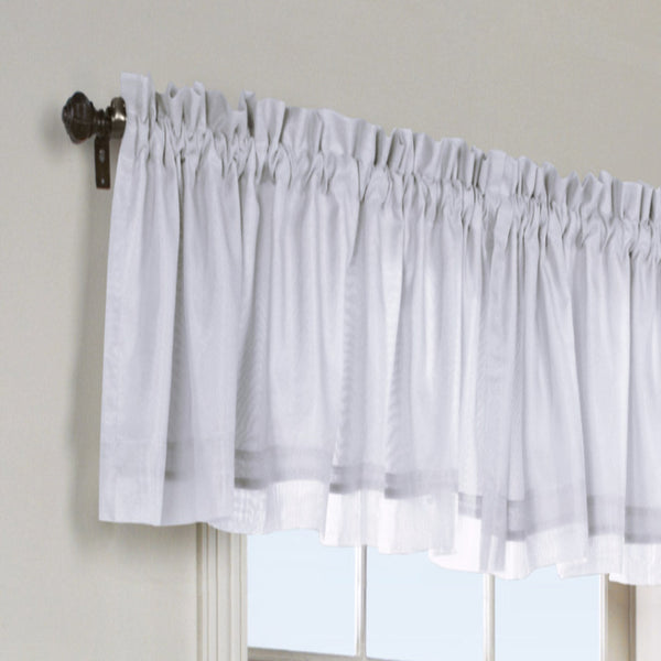 White Rhapsody Lined Thermavoile Tailored Kitchen Valance hanging on a decorative rod