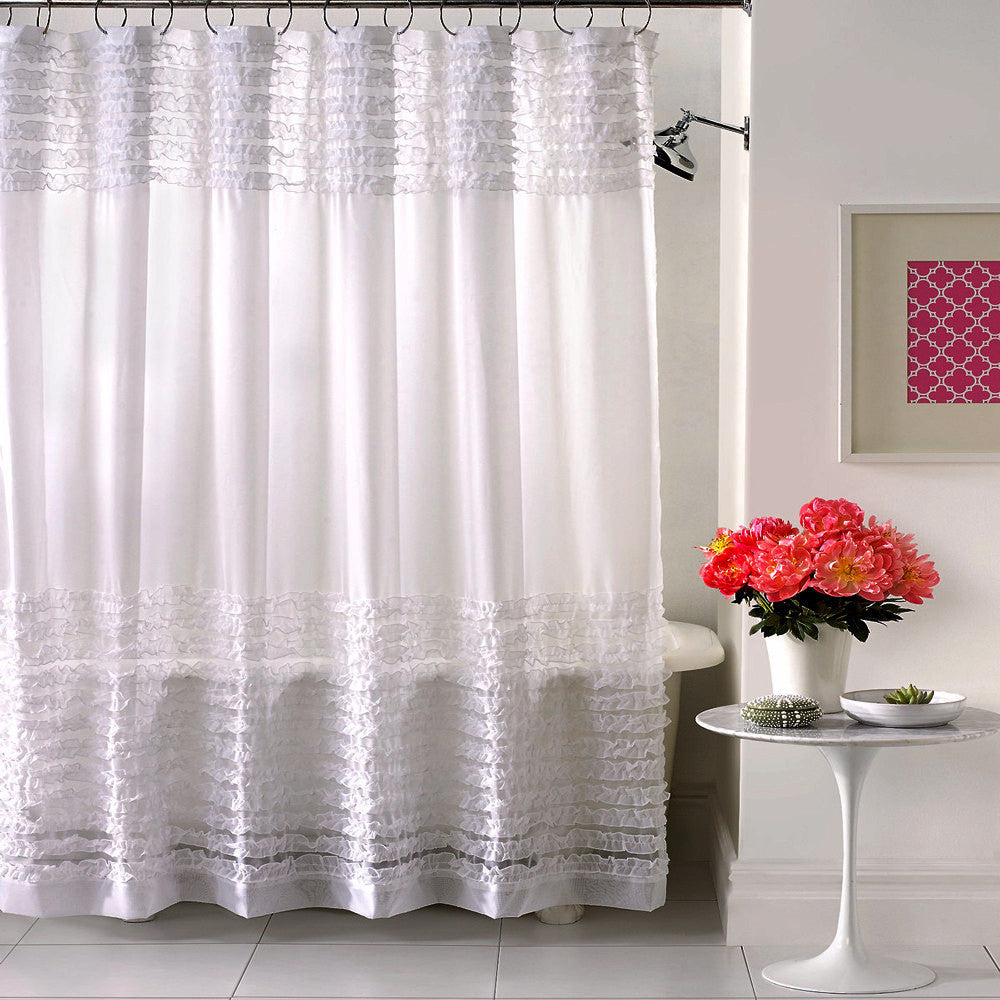 White Ruffles Sheer Shower Curtain hanging on a shower curtain rod