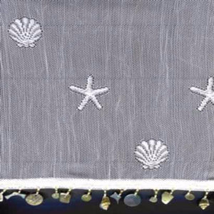Closeup of white Sand Shell Tier and Valance with Seashell Trim and fabric