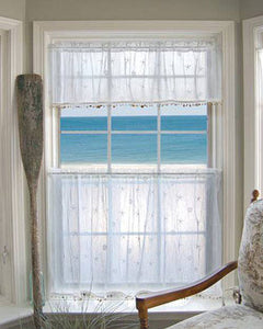 White Sand Shell Tier and Valance with Seashell Trim hanging on a curtain rod