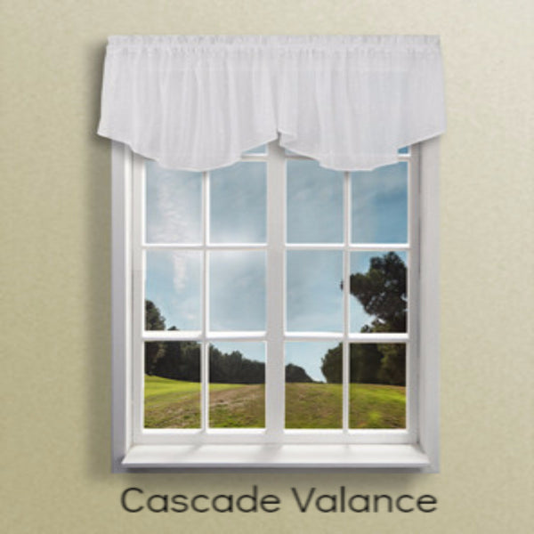 Ricardo Sea Glass Swag Curtains and Valance hanging on a curtain rod