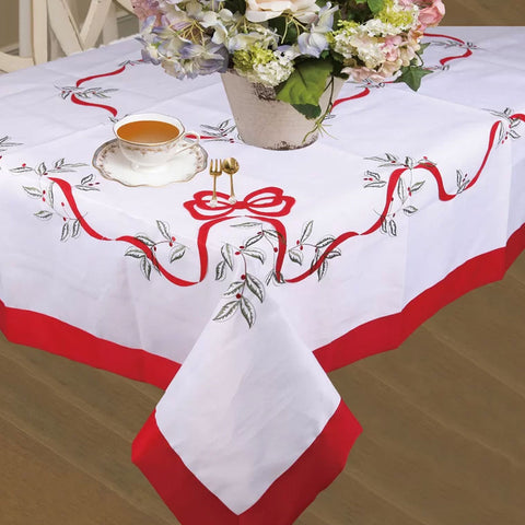 White Euro Seasonal Bows Fabric Tablecloth over a table