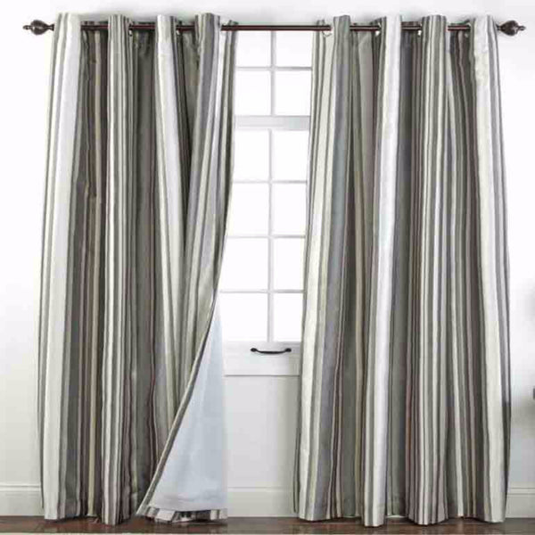 Serene Striped Grommet Top Panels hanging on a decorative curtain rod