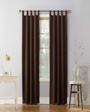 Chocolate Sun Zero Shandriah Room Darkening Tab Top Panel hanging off from a decorative rod